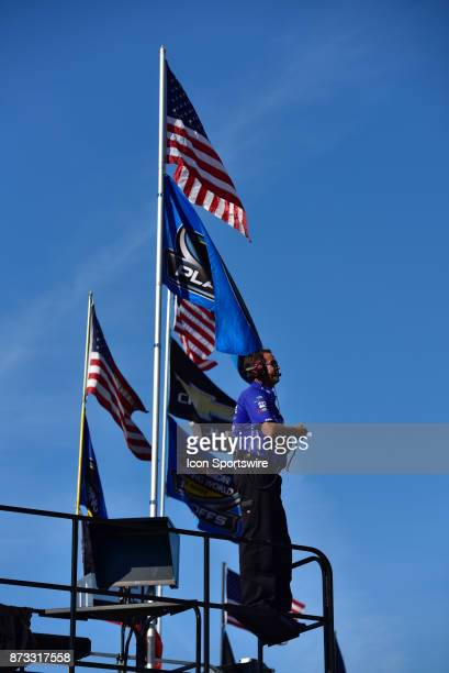 Crew member is standing high above on the truck hauler watching the racing action at the NASCAR Playoff Lucas Oil 150 on November 10 2017 at the...