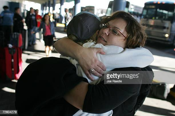 Crew member Jessica Newman is hugged after disembarking from the Carnival Liberty Cruise ship at Port Everglades on November 19 2006 in Fort...