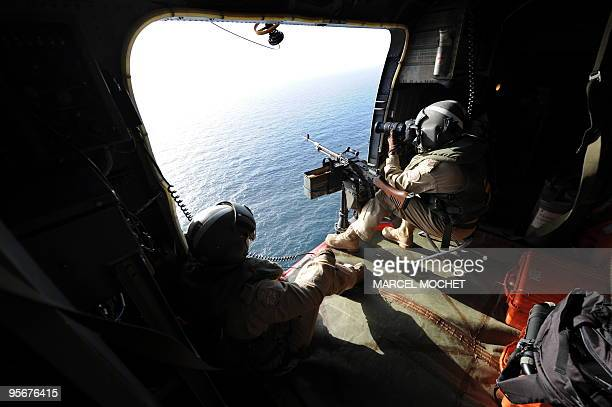 A crew member of Canadian helicopter SeaKing of the military ship Fredericton supervises the area during a security patrol on January 9 2010 in the...