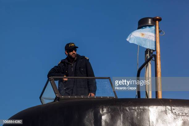 Crew member of submarine ARA San Juan embarks for an expedition after the mid-life upgrade reparation at Tandanor shypyard on June 02, 2014 in Buenos...