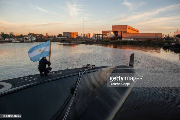 Crew member of submarine ARA San Juan embarks to set sail after complete the mid-life upgrade reparation at Tandanor shypyard on June 02, 2014 in...