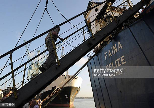 A crew member of the Belize flagged transport vessel MV Faina ascends its gangway on February 12 2009 The ship has berthed at the port of Mombasa and...