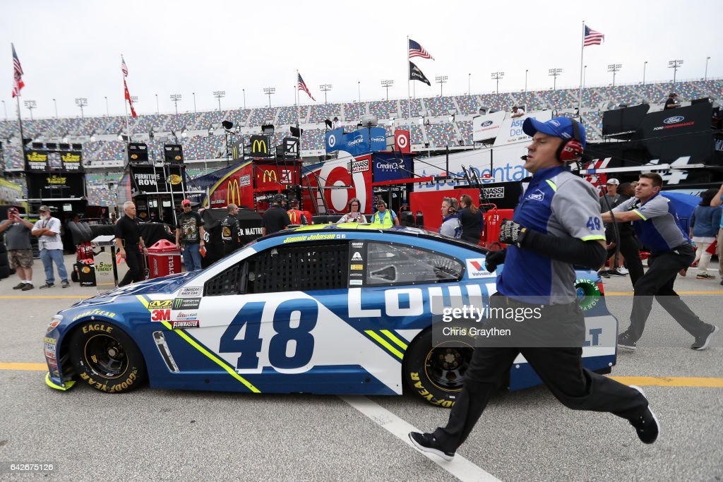 A crew member of the #48 Lowe's Chevrolet, driven by Jimmie Johnson, runs in the garage during practice for the Monster Energy NASCAR Cup Series 59th Annual DAYTONA 500 at Daytona International Speedway on February 18, 2017 in Daytona Beach, Florida.