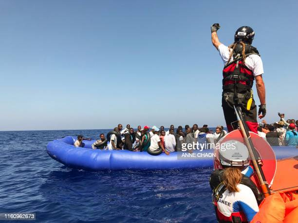 A crew member of the 'Ocean Viking' rescue ship operated by French NGOs SOS Mediterranee and Medecins sans Frontieres stands ready on board of a rhib...