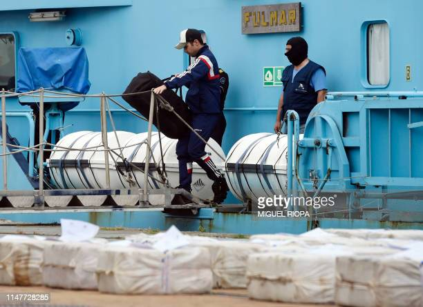 A crew member of the vessel Gure Leire is watched by Spanish customs officers in the port of Vigo on June 3 2019 as he leaves the Customs...