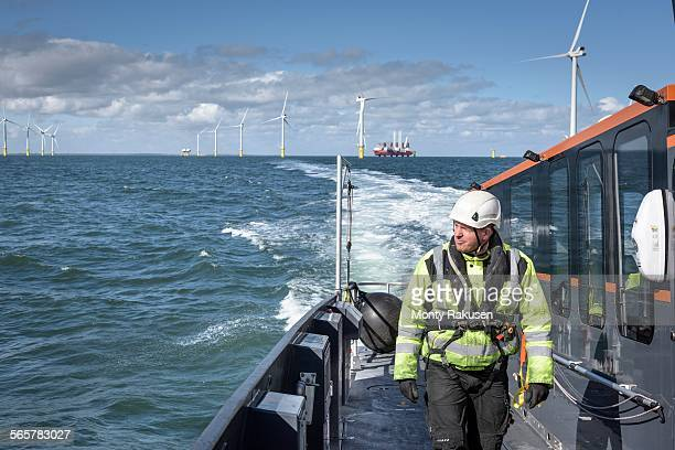 Crew member on deck of boat on offshore wind farm