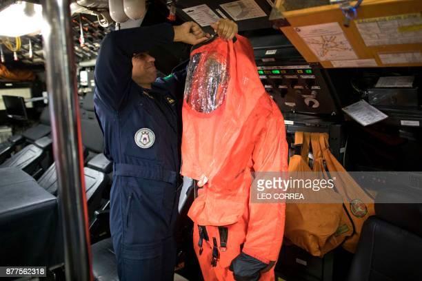 A crew member prepares emergency gear during a presentation to the press inside the Brazilian submarine Timbira in Rio de Janeiro Brazil on November...