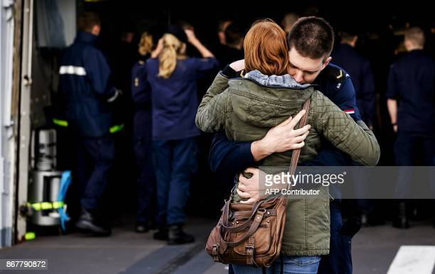 A crew member says goodbye to a relative as the fregat Zr Ms Van Speijk leaves to the Caribbean area from Den Helder on October 29 2017 The ship will...