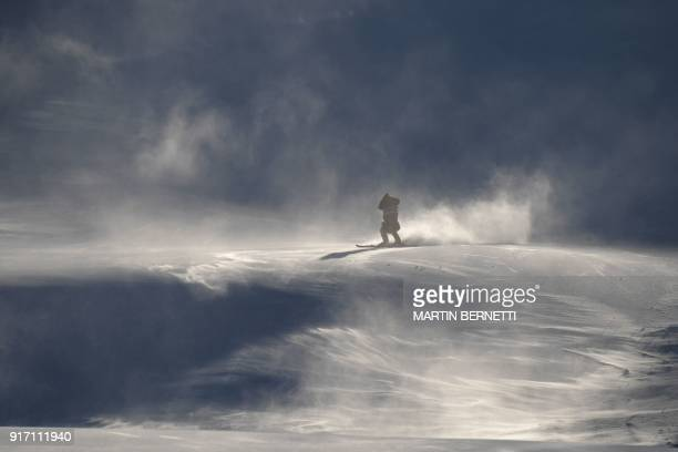 TOPSHOT A crew member skis slowly down the slopes after the Women's Giant Slalom was cancelled because of strong winds at the Jeongseon Alpine Center...