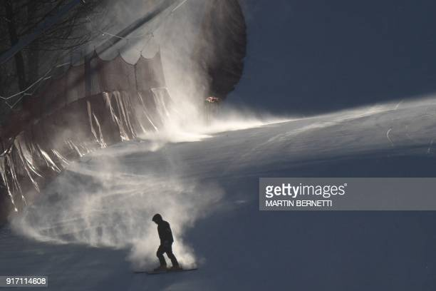 A crew member skis slowly down the slopes after the Women's Giant Slalom was cancelled because of strong winds at the Jeongseon Alpine Center during...