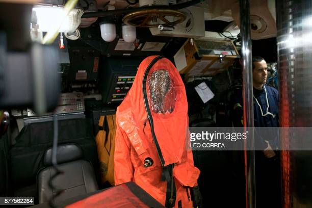 A crew member stands near emergency gear during a presentation to the press inside the Brazilian submarine Timbira in Rio de Janeiro Brazil on...