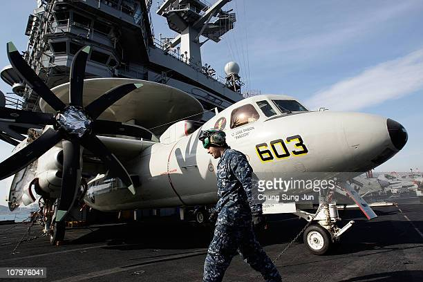 Crew member stands on the flight deck of Aircraft Carrier USS Carl Vinson whilst at anchor in Busan port on January 11 2011 in Busan The USS Carl...