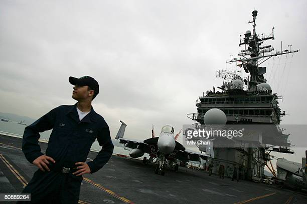 Crew member stands watch on the flight deck of the USS Kitty Hawk on April 28, 2008 in Hong Kong, China. The battle carrier group made its first stop...