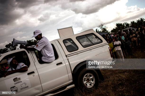 A crew member tours the village announcing a live broadcasting of the Football World Cup quarter final match organised by the Italian Agency for...