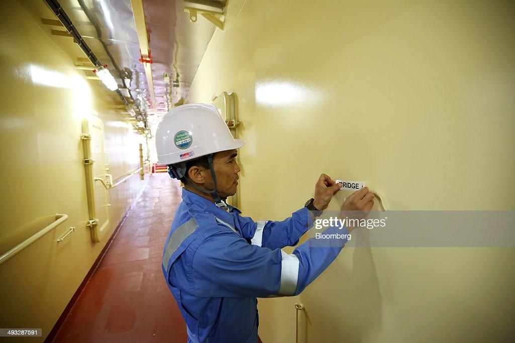 A crew member works below deck aboard the Marstal Maersk