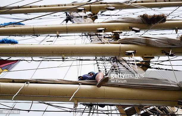 A crew member works high in the rigging as he checks the sails during the North Sea Tall Ships Regatta on August 27 2016 in Blyth England The...