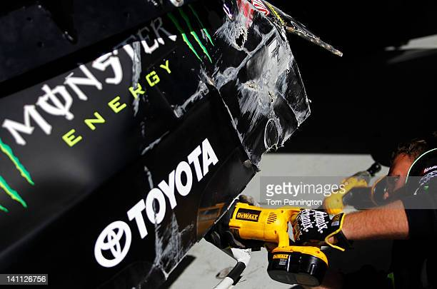 A crew member works on the wrecked Monster Energy Toyota on pit road after an incident in the NASCAR Nationwide Series Sam's Town 300 at Las Vegas...