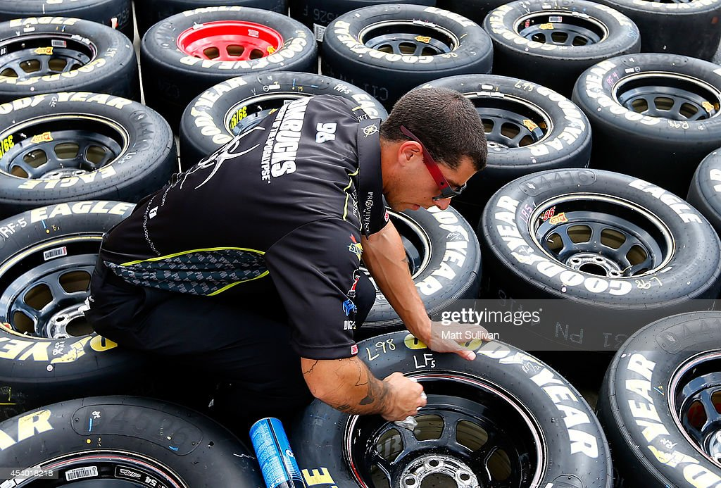 A crew member works on tires prior to the NASCAR Sprint Cup Series Irwin Tools Night Race at Bristol Motor Speedway on August 23, 2014 in Bristol, Tennessee.