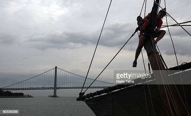 A crew member works the Half Moon a replica of the ship Henry Hudson sailed when he discovered Manhattan in front of the VerrazanoNarrows Bridge...