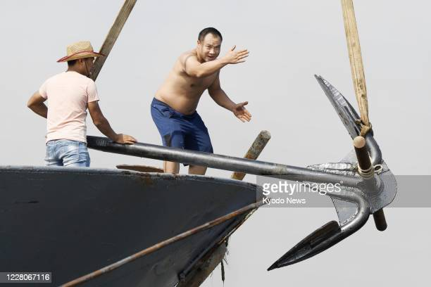 Crew members aboard a Chinese fishing vessel prepare to leave a port in Shishi in Fujian Province on Aug 16 2020 A Chineseset suspension of fishing...