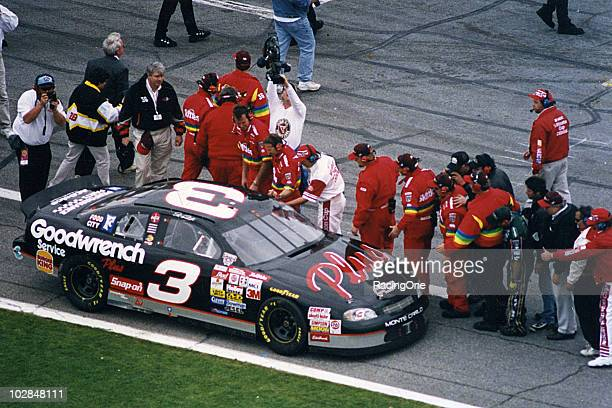 Crew members along pit road congratulate Dale Earnhardt following his victory in the Daytona 500 at Daytona International Speedway