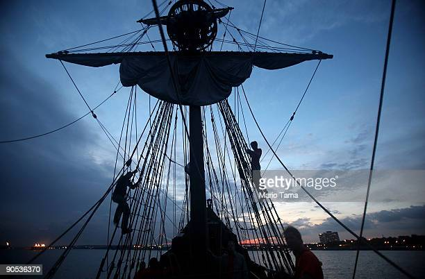 Crew members climb the rigging on the Half Moon a replica of the ship Henry Hudson sailed when he discovered Manhattan September 9 2009 off the coast...
