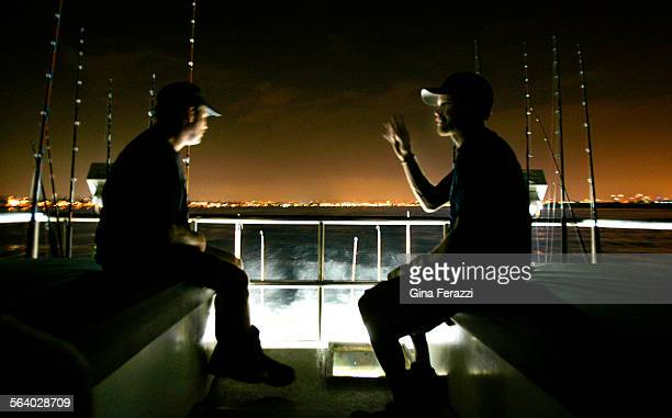 Crew members Dave Grudzienleft and Greg 'Willow' Vanderlinden sit on the sundeck to chat as the Gallilean tuna fishing charter sets out for a fishing...
