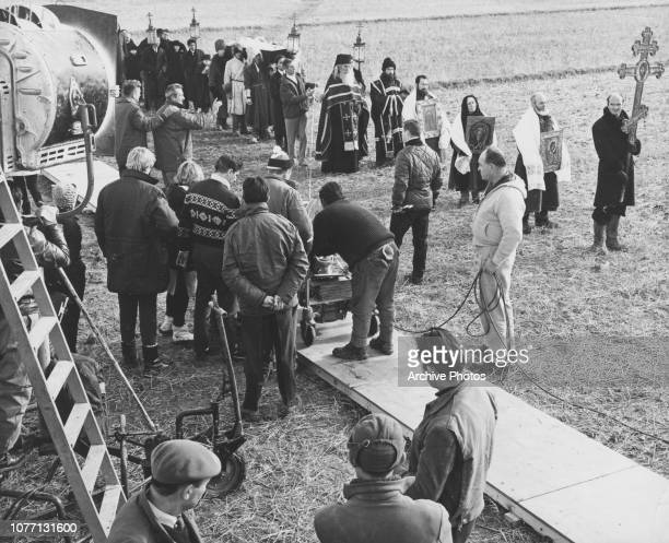 Crew members filming the funeral scene for the movie 'Doctor Zhivago' 1965 Director David Lean is visible at the top left with his hand on another...