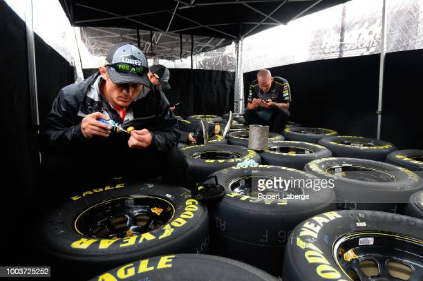 Crew members for Jimmie Johnson driver of the Lowe's for Pros Chevrolet prepare Goodyear Eagle tires for the Monster Energy NASCAR Cup Series...