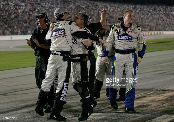 Crew members for Jimmie Johnson driver of the Lowe's/Kobalt Chevrolet celebrate on pit road after winning the NASCAR Nextel Cup Series Dickies 500 at...