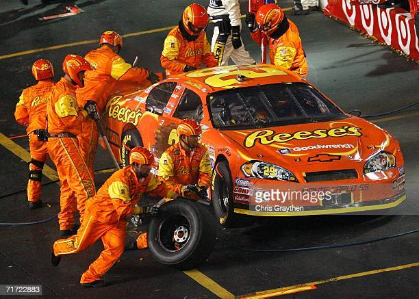 Crew members for Kevin Harvick driver of the Reese's Chevrolet work on the car during a pit stop during the NASCAR Nextel Cup Series Sharpie 500 on...