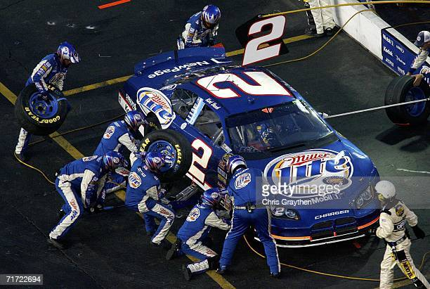 Crew members for Kurt Busch driver of the Miller Lite DOdge work on the car during a pit stop during the NASCAR Nextel Cup Series Sharpie 500 on...