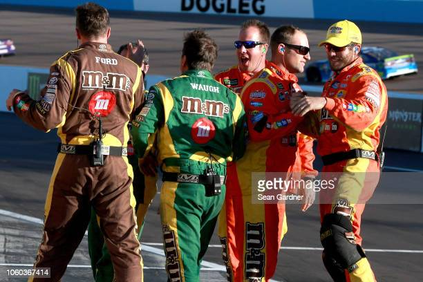 Crew members for Kyle Busch driver of the MM's Toyota celebrate on pit road after winning the Monster Energy NASCAR Cup Series CanAm 500 at ISM...