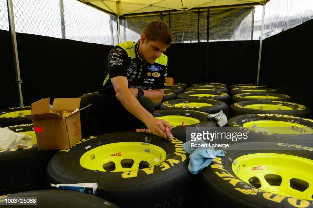 Crew members for Ryan Blaney driver of the Menards/Sylvania Ford prepare Goodyear Eagle tires for the Monster Energy NASCAR Cup Series Foxwoods...