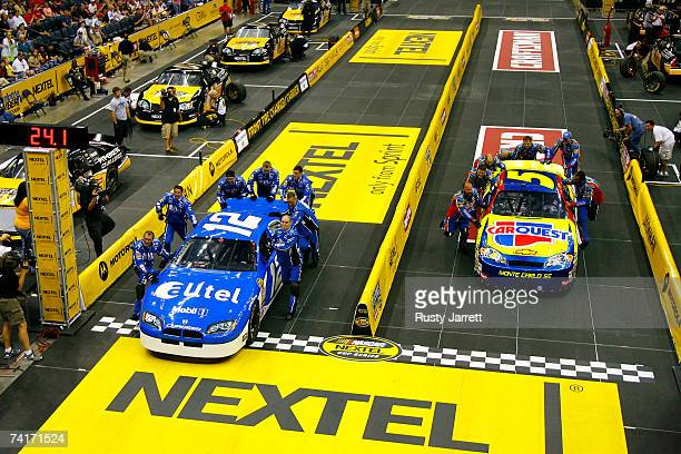 Crew members for the Alltel Dodge compete against the crew members for the Carquest/Kellogg's Chevrolet during the NASCAR Nextel Pit Crew Challenge...