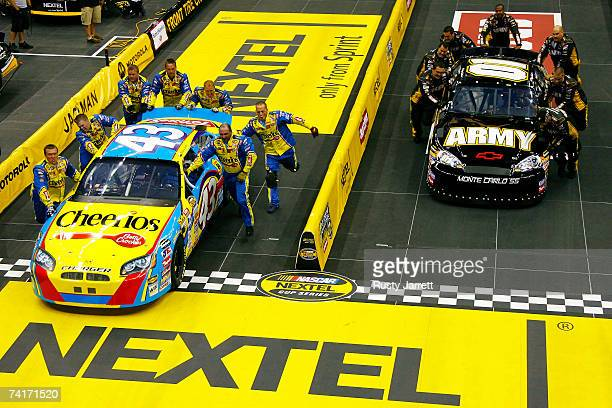 Crew members for the Cheerios/Betty Crocker Dodge compete against crew members for the US Army Chevrolet during the NASCAR Nextel Pit Crew Challenge...