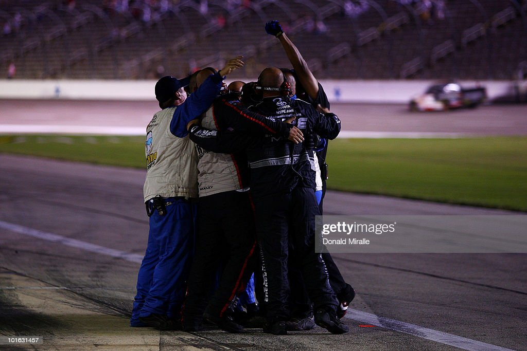 Crew members for Todd Bodine, driver of the #30 Germain.com Toyota, celebrate after winning the NASCAR Camping World Truck Series WinStar World Casino 400k at Texas Motor Speedway June 4, 2010 in Fort Worth, Texas.