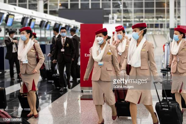 Crew members from Emirates airline are seen leaving Hong Kong international airport. Temporally 14 days new measures in response to the latest...