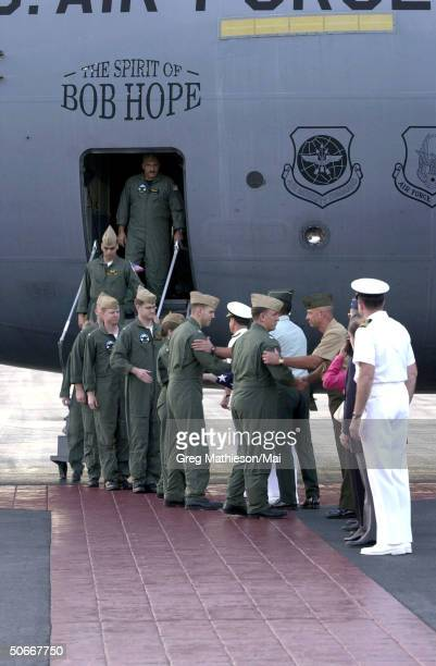 Crew members from US Navy EP3 Aries II aircraft involved in the April 1 accident with a Chinese F8 aircraft being welcomed by senior military...