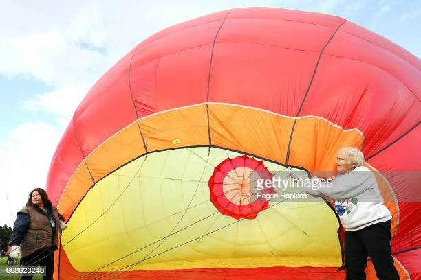 Crew members help inflate the 'Phoenix' balloon after poor weather kept pilots grounded during the Park to Paddock Challenge at the Wairarapa Balloon...