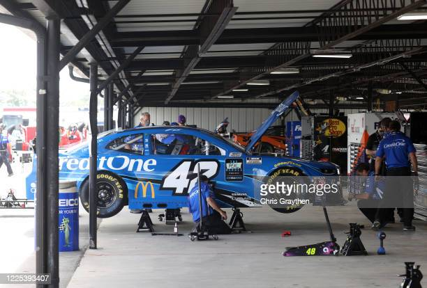 Crew members make adjustments to the Credit One Bank Chevrolet driven by Matt Kenseth in the garage area prior to the NASCAR Cup Series The Real...