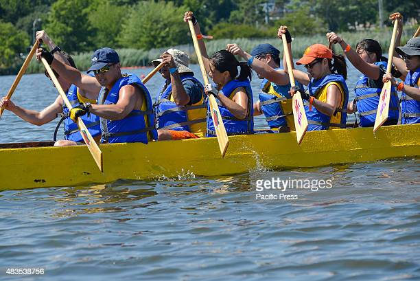 Crew members of a dragon boat team paddle their boat during a race The twoday 25th Annual Hong Kong Dragon Boat Festival was held in Flushing...
