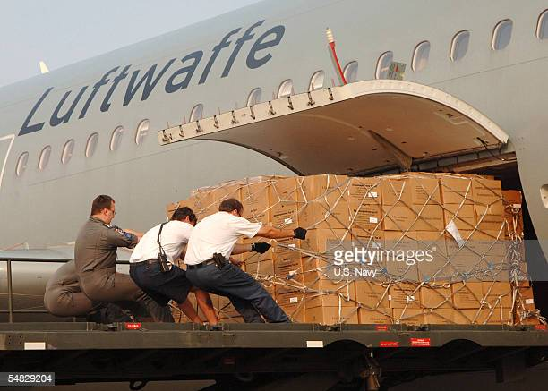 Crew members of a German Air Force A-310 aircraft offload Meals Ready-to-Eat on board Naval Air Station in support of Hurricane Katrina relief...