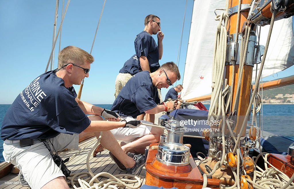 Crew members of a luxury yacht manoeuvre on May 25, 2010 off Ajaccio, on the French mediterranean island of Corsica, during the Regates Imperiales (Imperial regattas).