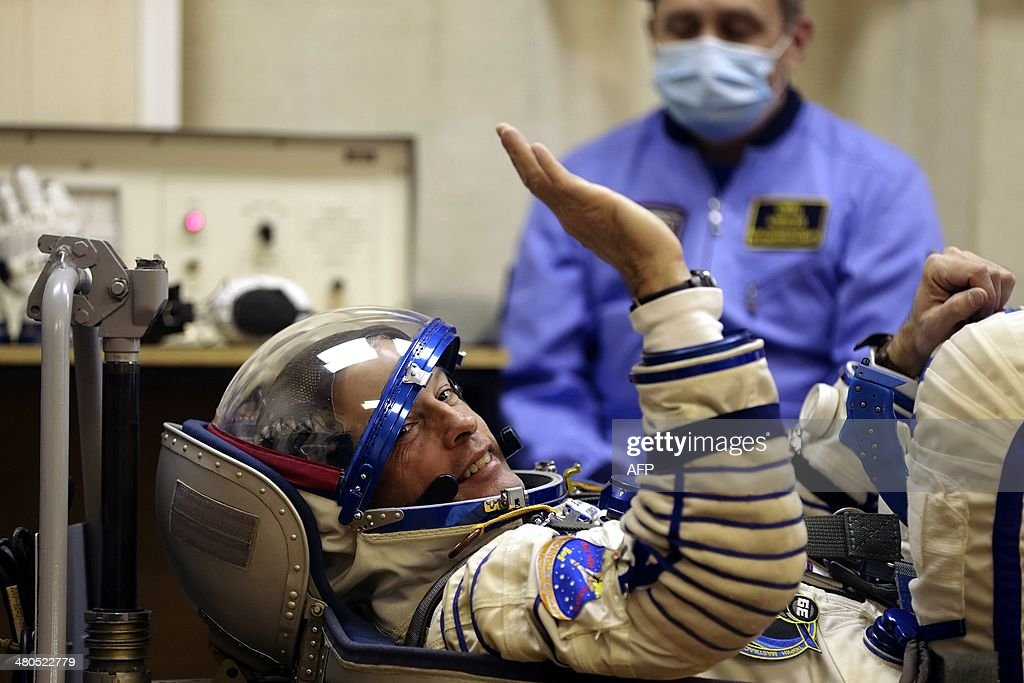 A crew members of a mission to the International Space Station (ISS), US astronaut Steven Swanson tests a space suit during the pre-launch preparations at the Russian-leased Baikonur cosmodrome i Kazakhstan, on March 25, 2014. The launch of the international crew, including Swanson and Russian cosmonauts Alexander Skvortsov and Oleg Artemyev , is scheduled early on March 26.