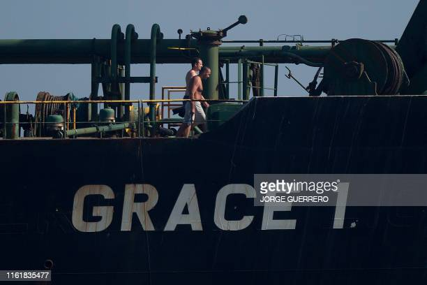 TOPSHOT Crew members of Iranian supertanker Grace 1 walk on board off the coast of Gibraltar on August 15 2019 Gibraltar's Supreme Court ruled today...