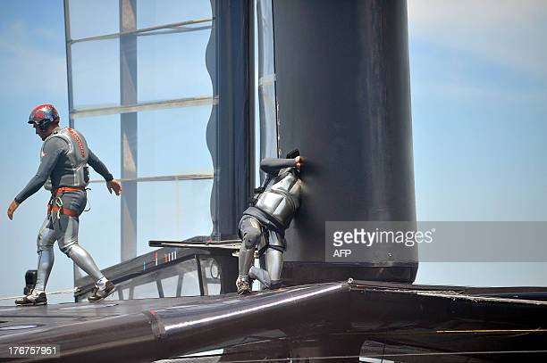 Crew members of Luna Rossa Challenge inspect their AC72 after winning the second finals race of the Louis Vuitton Cup in San Francisco California on...