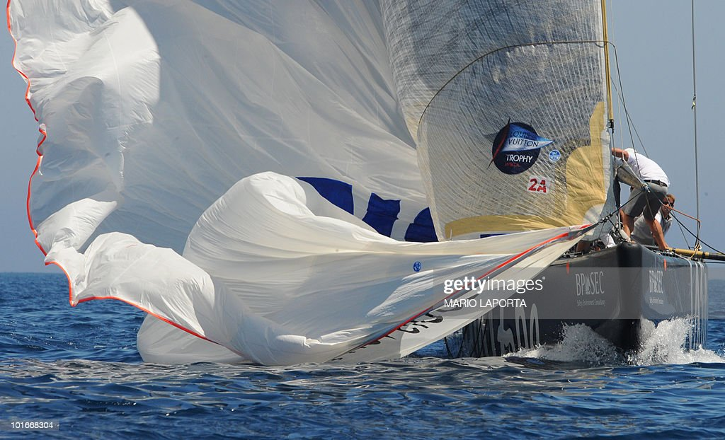 Crew members of Russian Sailing Team Sinergy recover the spinnaker during the final match race of the Louis Vuitton Trophy Emirates New Zealand Team at La Maddalena Island, on June 6, 2010, after a two-week regatta that started on May 22 and finished on June 6, 2010. Emirates New Zealand won 3-2.