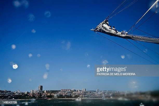 Crew members of Spanish sailing boat Juan Sebastian De Elcano work on board in Lisbon on July 22 during the Tall Ships' races 2012 an international...