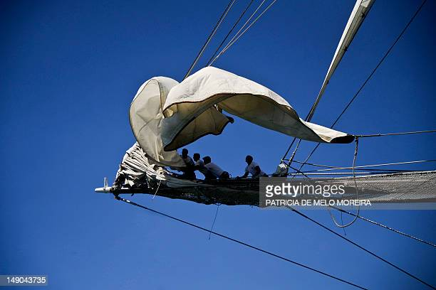 Crew members of Spanish sailing boat Juan Sebastian De Elcano work on board in Lisbon on July 22 during the Tall Ships' races 2012 an international...